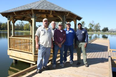 "Parish employees (from left) Thomas Nicholson, Nelson Aymond, Hubert ""Cue Ball"" James, Richard Gautreaux and Leroy Anderson take a moment for a picture at the new handicap-accessible fishing pier and gazebo at Lamar-Dixon Expo Center."